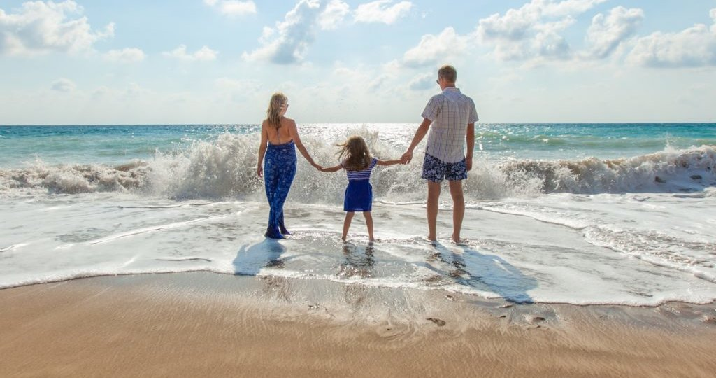 family-on-beach-looking-at-ocean-e1520352309941-1024x718