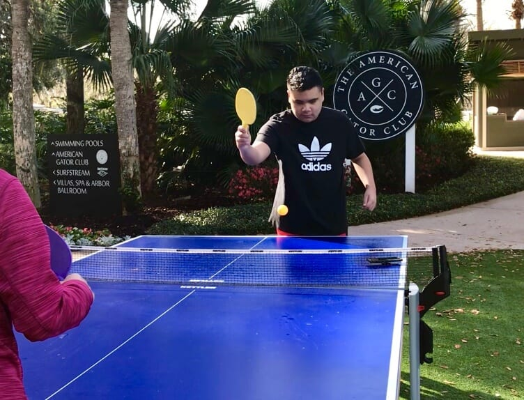 Child with autism playing ping pong at Sawgrass Marriott