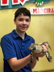 Son holding gator