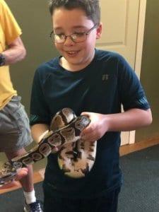 son holding snake