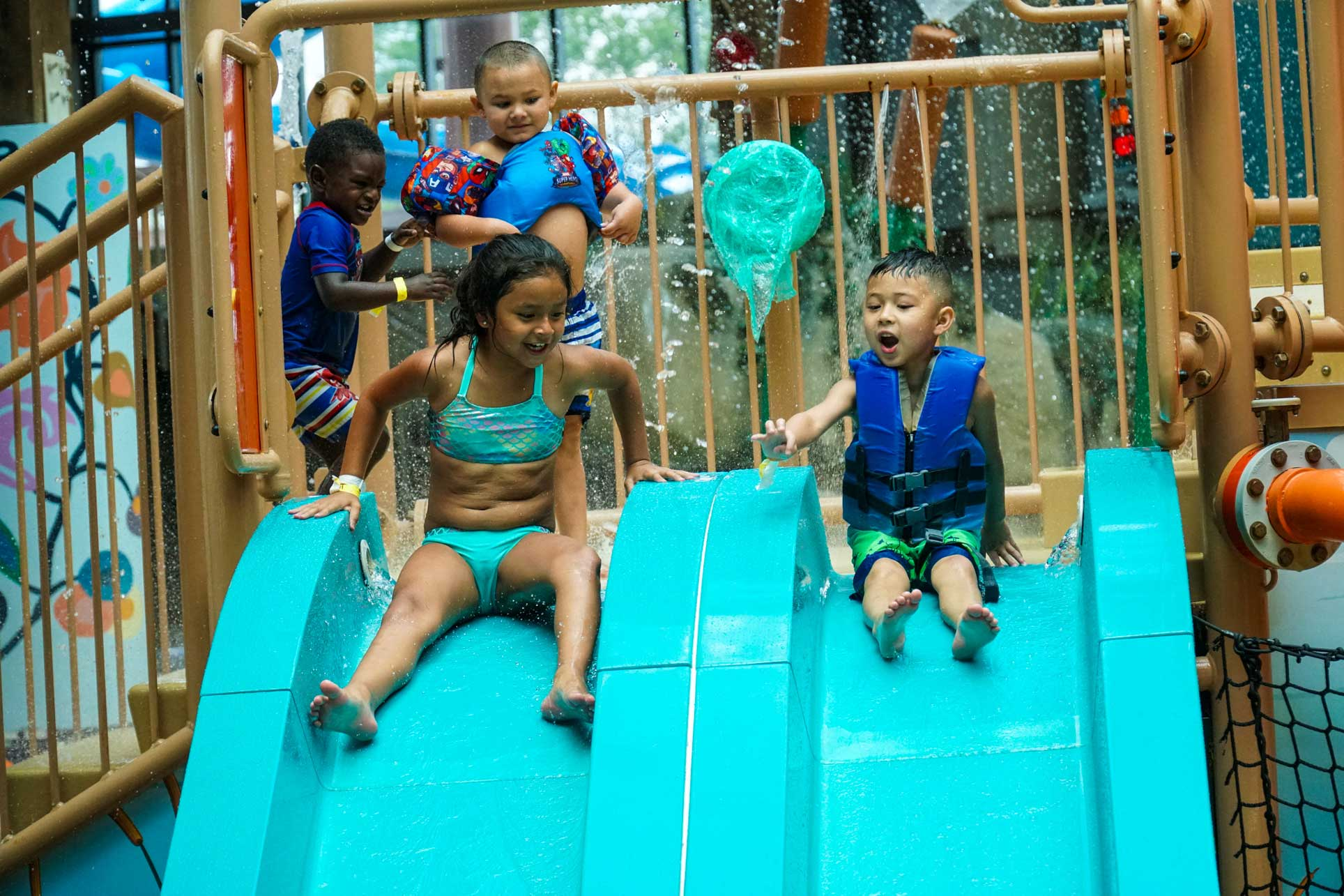 Soaring Eagle kids on slide