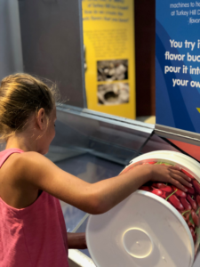 girl enjoying interactive portion of the Turkey Hill Experience