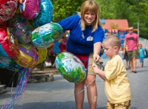 young boy getting ballon from Knoebels staff