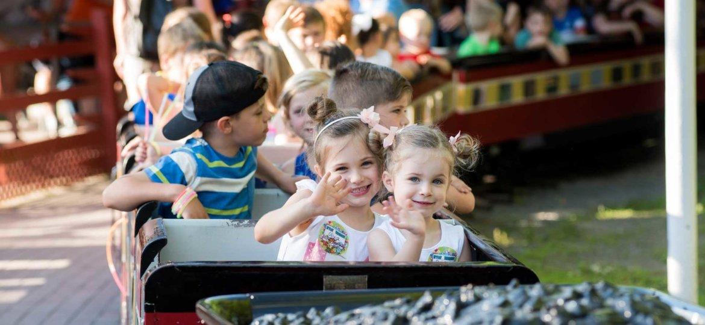 Knoebels young girls enjoying train ride together