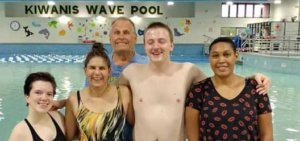 group of swimmers smiling at the Kiwanis Rec Pool