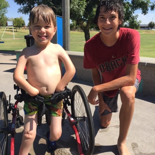 2 Boys smiling at Splash Pad at Kiwanis Park in Tempe