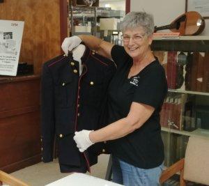 PCHS staff handling military uniform