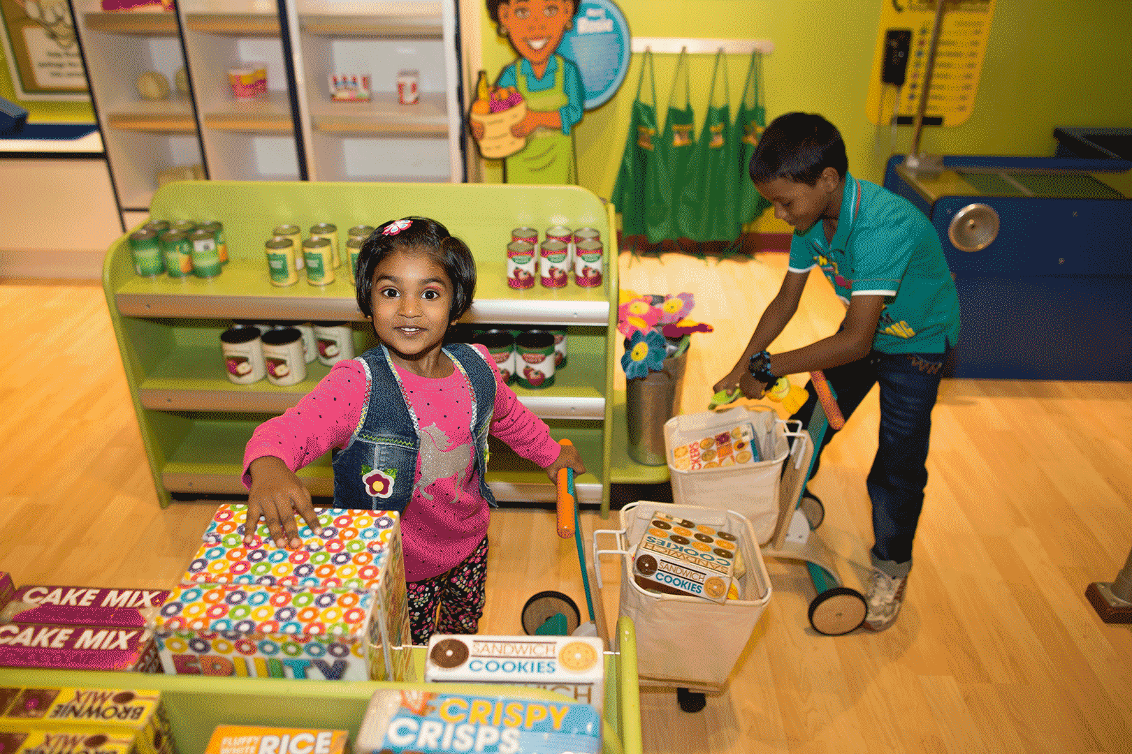 Young boy and girl playing market at Family Museum
